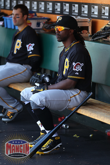 SAN FRANCISCO - APRIL 13:  Andrew McCutchen of the Pittsburgh Pirates gets ready in the dugout before the game against the San Francisco Giants at AT&T Park on April 13, 2012 in San Francisco, California. (Photo by Brad Mangin)