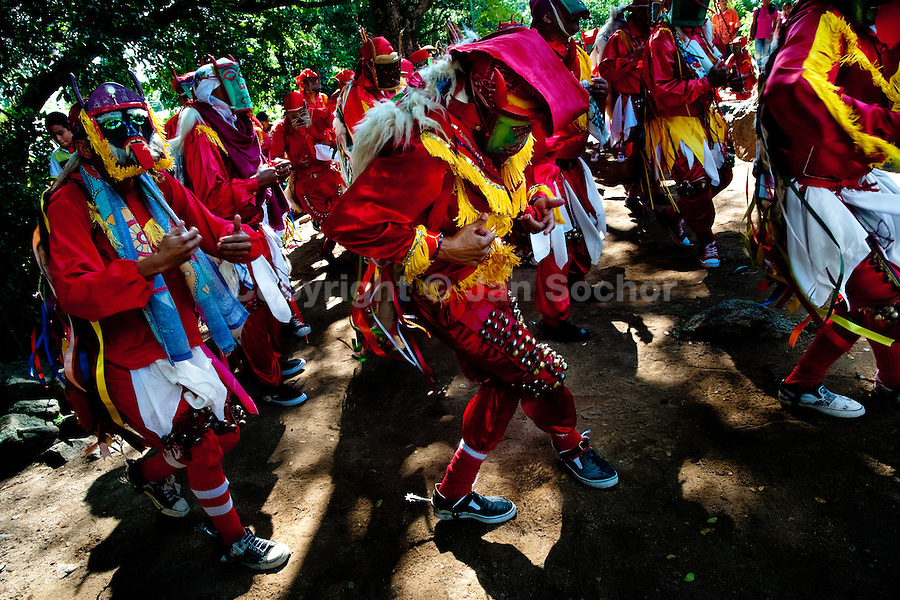 """The Devils (Diablos) dance during the religious procession in Atanquez, Sierra Nevada, Colombia, 3 June 2010. A colorful celebration of Corpus Christi is held in the Kankuamo Indians territory every year. """"The Dance of the Devils"""" is an ancient tradition kept for centuries on the Colombia's Caribbean coast. This Christian religious event usually coincides with the summer solstice, which has always been the key point for the native cultures and for the black African slaves. Due to this confluence, the Kankuamo myths, the African animistic rites and other Pre-Columbian features have blended with the Spanish Catholic festival into a lively spectacle."""