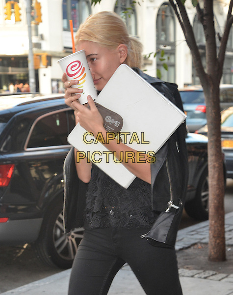 NEW YORK, NY - SEPTEMBER 1: Hailey Baldwin hides her face with a Jamba Juice cup in New York, New York on September 1, 2014. <br /> CAP/MPI/RW<br /> &copy;RW/MPI/Capital Pictures