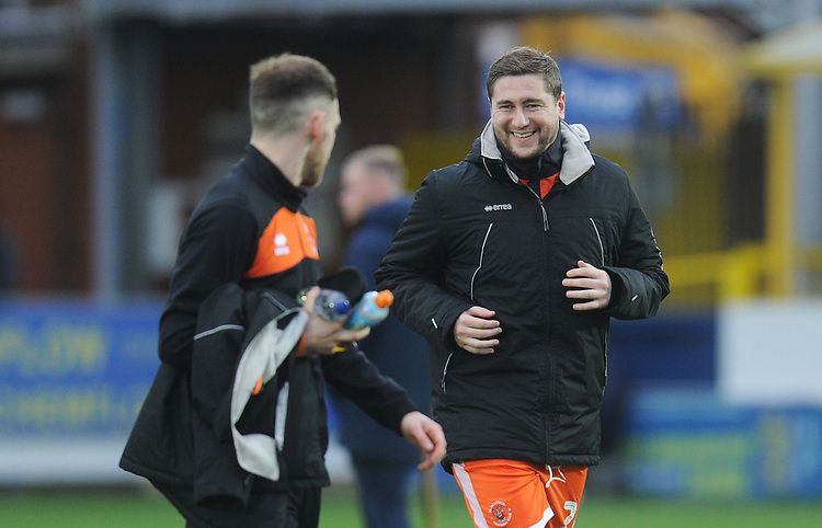 Blackpool's Steve Davies shares a smile with Harry Pritchard<br /> <br /> Photographer Kevin Barnes/CameraSport<br /> <br /> The EFL Sky Bet League One - AFC Wimbledon v Blackpool - Saturday 29th December 2018 - Kingsmeadow Stadium - London<br /> <br /> World Copyright © 2018 CameraSport. All rights reserved. 43 Linden Ave. Countesthorpe. Leicester. England. LE8 5PG - Tel: +44 (0) 116 277 4147 - admin@camerasport.com - www.camerasport.com