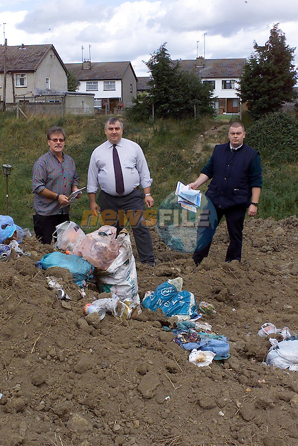 San Collins centre with john Lenord Drogheda partnership and The Litter Warded going through the rubbish that has been left in the cleaned area between rathmullen and Ballsgrove..Picture Fran Caffrey Newsfile.