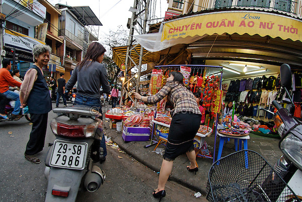 Asia, Vietnam, Hanoi. Hanoi old quarter. Vietnamese women doing the shopping from their motorbike.