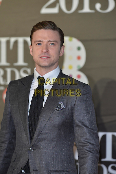Justin Timberlake.The Brit Awards 2013 arrivals at the O2, Greenwich, London, England 20th February 2013.The Brits half length grey gray suit black tie white shirt.CAP/PL.©Phil Loftus/Capital Pictures.