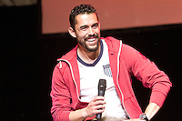 Herculez Gomez answers a question on the stage at the Paramount Theater in Denver, CO during the USA Men's National Team prep rally on March 21, 2013.