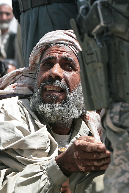 Anxiety is etched in a man's face as he waits to receive free medical assistance, food staples and winter clothes from U.S. troops and Afghan police in Kandahar, Afghanistan. Aug. 18, 2008. DREW BROWN/STARS AND STRIPES