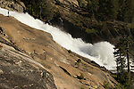 Hiker next to rushing water, Waterwheel Falls, Tuolumne  River, Grand Canyon of the Tuolumne, Yosemite National Park, Sierra Nevada, California