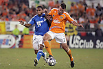 10 November 2007:  Eddie Robinson (2) of the Houston Dynamo and Scott Sealy (19) of the Kansas City Wizards battle for a loose ball.  The MLS Houston Dynamo defeated the Kansas City Wizards 2-0 at Robertson Stadium, Houston, Texas to capture the 2007 MLS Western Conference title and to advance to the MLS Cup championship final on Saturday, November 18th.