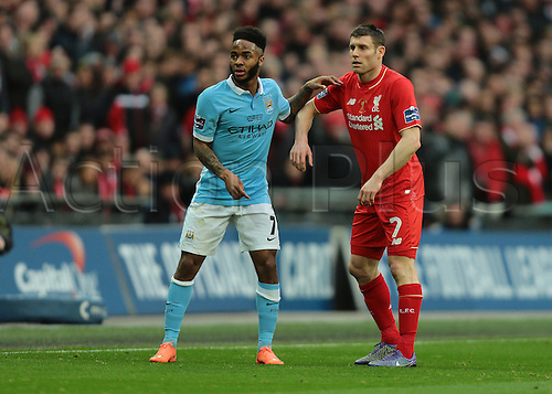 28.02.2016. Wembley Stadium, London, England. Capital One Cup Final. Manchester City versus Liverpool. Liverpool Midfielder James Milner and Manchester City Midfielder Raheem Sterling prepare for a Manchester City throw in