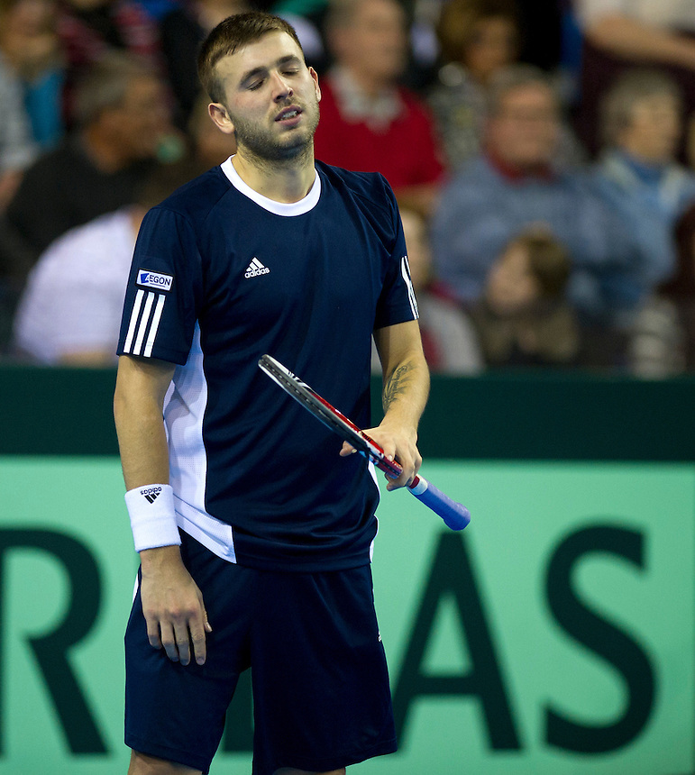 Great Britain's Dan Evans shows his frustration during his defeat Russia's Dmitry Tursunov by in their singles match today - Dimitry Tursunov def Dan Evans 6-4 6-7 (5-7) 6-4 5-7 6-4.. - Credit - CameraSport - Stephen White..International Tennis -  - Davis Cup by BNP Paribas - Europe/Africa Zone Group I Second Round - Great Britain v Russia - Day 1 - Friday 5th April 2013 - Ricoh Arena - Coventry - UK..© CameraSport - 43 Linden Ave. Countesthorpe. Leicester. England. LE8 5PG - Tel: +44 (0) 116 277 4147 - admin@camerasport.com - www.camerasport.com