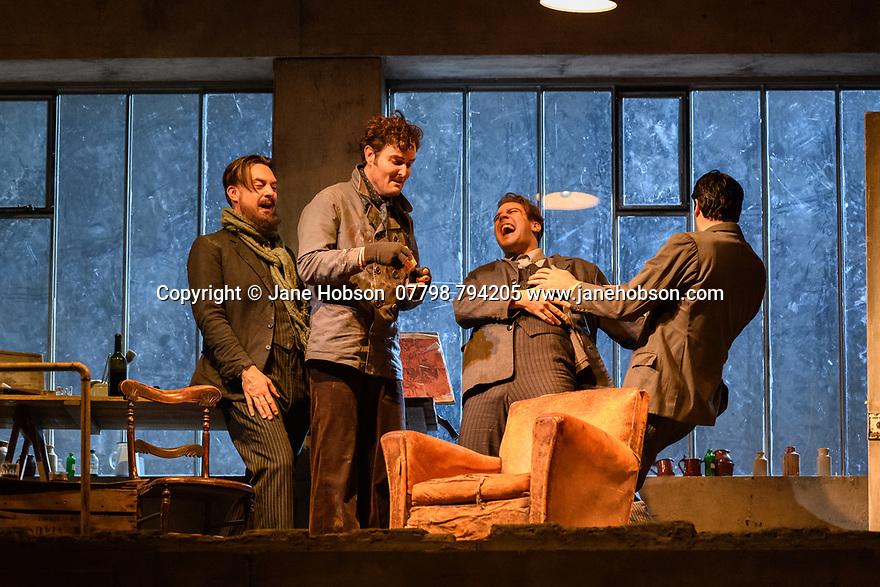 "London, UK. 24.11.2018. English National Opera present their fourth revival of Jonathan Miller's production of Puccini's ""La Boheme"", in which Natalya Romaniw makes her ENO debut. Cast is: Natalya Romaniw (Mimi), Jonathan Tetelman (Rodolfo), Nicholas Lester (Marcello), Simon Butteriss (Benoit/Alcindoro), Nadine Benjamin (Musetta), David Soar (Colline), Bozidar Smiljanic (Schaunard). Picture shows: David Soar (Colline), Nicholas Lester (Marcello), Bozidar Smiljanic (Schaunard), Jonathan Tetelman (Rodolfo). Photograph © Jane Hobson."