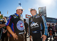 Nov 13, 2016; Pomona, CA, USA; NHRA funny car driver John Force (right) with teammate Robert Hight during the Auto Club Finals at Auto Club Raceway at Pomona. Mandatory Credit: Mark J. Rebilas-USA TODAY Sports
