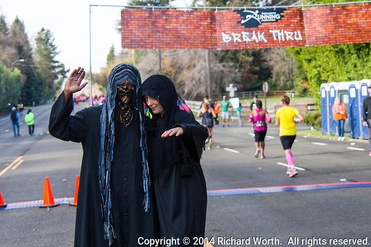 Grim Reapers stationed at The Wall encouraged runners to forego the afterlife and Keep Running!