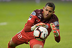 Goalkeeper Jose Guerra of Independiente dives and saves a shot on goal. Sporting KC defeated Club Atletico Independiente 3-0 in a CONCACAF Champions League quarterfinal game at Children's Mercy Park on March 14, 2019.