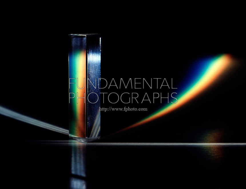 PRISM REFRACTS WHITE LIGHT TO FORM CURVED SPECTRUM<br /> The various wavelengths of visible light, a small part of the electromagnetic spectrum, are separated because the refractive index of the prism substance varies for the different wavelengths.