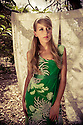Model wearing green vintage hawaiian print long tank dress  in plumeria grove.  Model is Laura Rego and Photograpy by Liisa Roberts.  Editorial title Pretty in Plumeria