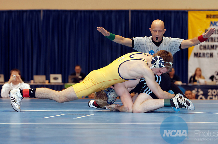 12 MAR 2011: Trevor Franklin of Upper Iowa (in black) wrestles Alex Meger of Augustana  during the Division II Men's Wrestling Championship held at the UNK Health and Sports Center on the University of Nebraska - Kearney campus in Kearney, NE. Franklin defeated Meger 3-0 to win the 125-lb national title.  Scott Anderson/NCAA Photos