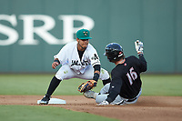 Augusta GreenJackets shortstop Anyesber Sivira (40) applies the tag to Michael Hickman (16) of the Kannapolis Intimidators as he slides into second base at SRG Park on July 6, 2019 in North Augusta, South Carolina. The Intimidators defeated the GreenJackets 9-5. (Brian Westerholt/Four Seam Images)