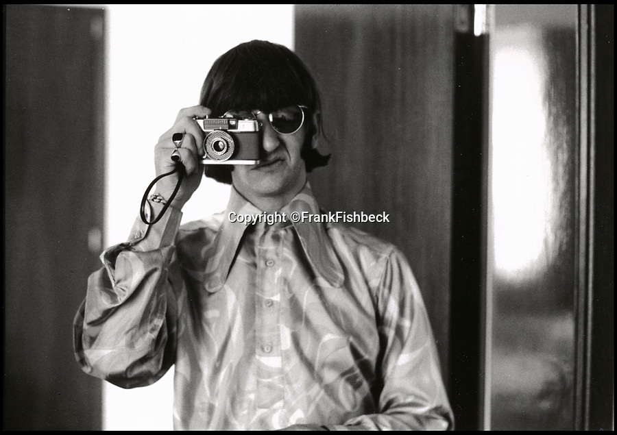 BNPS.co.uk (01202 558833)<br /> Pic: FrankFischbeck/Spink/BNPS<br /> <br /> Ringo with one of Fishbeck's camera's at their Munich hotel.<br /> <br /> Unseen photos of the fab four touring Germany in 1966 are being sold showing the group just before they ditched the suits, gave up touring and embraced the flower power revolution.<br /> <br /> The candid snaps were taken by enterprising photographer Frank Fishbeck in Munich and Essen in June 1966 after he had managed to <br /> follow them into their Munich hotel and they invited him to their concert.