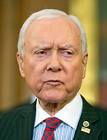 United States Senator Orrin Hatch (Republican of Utah), Chairman, US Senate Finance Committee, makes remarks as US Senate and House Republicans announce their new tax plan endorsed by US President Donald J. Trump in the US Capitol in Washington, DC on Wednesday, September 27, 2017.  Senator Hatch, as the most senior senator in the majority party, also serves as the president pro tempore of the US Senate, a position that puts him third in the line of succession to the US presidency. Photo Credit: Ron Sachs/CNP/AdMedia