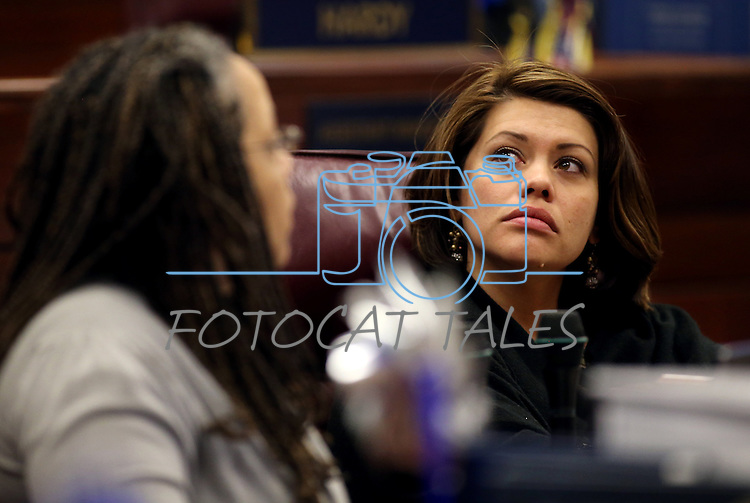 Nevada Assemblywoman Teresa Benitez-Thompson, D-Reno, watches the board on the Assembly floor during a special Legislative session in Carson City, Nev., on Tuesday, June 4, 2013. <br /> Photo by Cathleen Allison