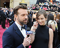 WWW.BLUESTAR-IMAGES.COM Actors Olivia Wilde (R) and Jason Sudeikis attend the 86th Annual Academy Awards held at Hollywood &amp; Highland Center on March 2, 2014 in Hollywood, California.<br /> Photo: BlueStar Images/OIC jbm1005  +44 (0)208 445 8588