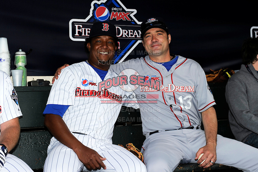 Former Boston Red Sox pitcher Pedro Martinez #45 in the dugout with former Detroit Tigers pitcher Greg Keagle during the MLB Pepsi Max Field of Dreams game on May 18, 2013 at Frontier Field in Rochester, New York.  (Mike Janes/Four Seam Images)