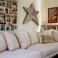 Film posters and memorabilia hang above the sofa in the  living room
