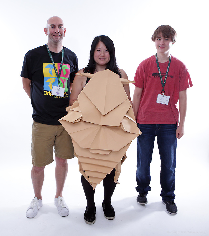 New York, NY, USA - June 24, 2018: Scenes from the Big Folding event at the annual OrigamiUSA Convention. Featured in this picture: Spencer Robinson, AL, Theresa Hong, NY, Brian Hoffman, VT. Model: Bedbug