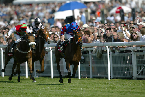 31 July 2004: Jockey RYAN MOORE rides EASY FEELING to victory in the Vodafone Racegoers Club Stakes at Goodwood Photo: Glyn Kirk/Action Plus...horse racing 040731 flat horses  glorious