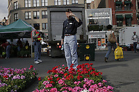 NEW YORK - MAY 06: People shop for flowers at the Farmer's Market in Union Square on Saturday, May 6, 2006 in New York City. (Photo by Landon Nordeman for The New Yorker)
