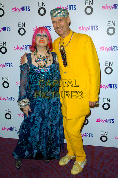 "ZANDRA RHODES & GUEST.The ""Aida"" press night, London Coliseum Theatre, London, England..November 8th, 2007.full length blue top blue sheer pattern print pink hair necklaces yellow suit gold hat .CAP/CAN.©Can Nguyen/Capital Pictures"