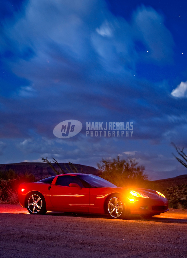 desert weather storm chaser chasing clouds sky Arizona mountain mountains sunset red Chevy Chevrolet Corvette 2008 sports car coupe dirt road gravel night automobile automotive
