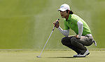 SUZHOU, CHINA - APRIL 17:  Kim Dae-hyun of Korea lines up a putt on the 1st green during the Round Three of the Volvo China Open on April 17, 2010 in Suzhou, China. Photo by Victor Fraile / The Power of Sport Images