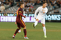 Melbourne, 18 July 2015 - Cristiano Ronaldo of Real Madrid passes the ball looking the other way in game one of the International Champions Cup match at the Melbourne Cricket Ground, Australia. Roma def Real Madrid 7-6 Penalties. Photo Sydney Low/AsteriskImages.com