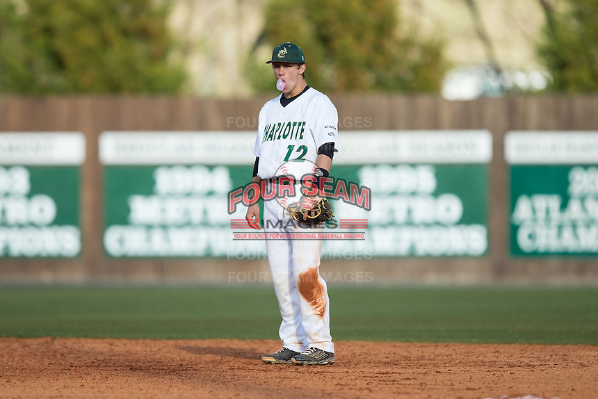 Charlotte 49ers shortstop Luke Gibbs (12) blows a bubble during the game against the Florida Atlantic Owls at Hayes Stadium on March 14, 2015 in Charlotte, North Carolina.  The Owls defeated the 49ers 8-3 in game one of a double header.  (Brian Westerholt/Four Seam Images)