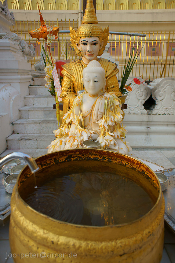 buddha with water bowl for ritual of washing Buddha (linked to birmese weekday birthday horoscope astrology)Shwedagon pagoda complex, Yangon, Myanmar, 2011