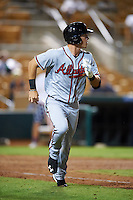 Salt River Rafters Dylan Moore (5), of the Atlanta Braves organization, jogs to first while watching a home run during a game against the Glendale Desert Dogs on October 19, 2016 at Camelback Ranch in Glendale, Arizona.  Salt River defeated Glendale 4-2.  (Mike Janes/Four Seam Images)