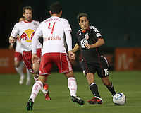 Josh Wolfe (16) of D.C. United slips the ball past Rafa Marquez (4) of the New York Red Bulls during an MLS match at RFK Stadium, in Washington D.C. on April 21 2011. Red Bulls won 4-0.