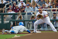 Mississippi State first baseman Wes Rea (35) catches a pickoff throw at first base during Game 1 of the 2013 Men's College World Series Finals as UCLA baserunner Kevin Kramer (7) dives back to the bag on June 24, 2013 at TD Ameritrade Park in Omaha, Nebraska. The Bruins defeated the Bulldogs 3-1, taking a 1-0 lead in the best of 3 series. (Andrew Woolley/Four Seam Images)
