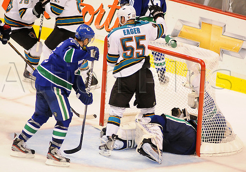 18.05.2011 San Jose Sharks forward Ben Eager (55) celebrates after scoring by taunting Vancouver Canucks goalie Roberto Luongo (1) and defender Christian Ehrhoff (5) during game 2 of the Western Conference Finals in Vancouver, British Columbia on Wednesday night.
