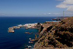 The port of Agaete below rugged Canarian mountain pass on the west coat of Gran Canarian, Mogan to Agaete road. Gran Canaria, Canary Islands, Spain.