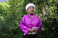 A local Tibetan woman in the Zharu valley, which is off-limits to most tourists except those on eco-tours. The relationship between the local Tibetan people and the natural environment is a close one and traditionally has been one of balance. The name Jiuzhaigou translates as Nine Village Valley, referring to the nine Tibetan villages which are located within the valleys of the park.