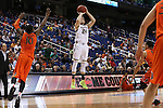 12 March 2015: Notre Dame's Pat Connaughton (24) shoots over Miami's Sheldon McClellan (10). The Notre Dame Fighting Irish played the University of Miami Hurricanes in an NCAA Division I Men's basketball game at the Greensboro Coliseum in Greensboro, North Carolina in the ACC Men's Basketball Tournament quarterfinal game. Notre Dame won the game 70-63.
