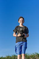 Teenager with DSLR camera.
