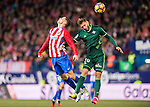 Fernando Torres of Atletico de Madrid fights for the ball with German Pezzella of Real Betis Balompie during their La Liga 2016-17 match between Atletico de Madrid vs Real Betis Balompie at the Vicente Calderon Stadium on 14 January 2017 in Madrid, Spain. Photo by Diego Gonzalez Souto / Power Sport Images