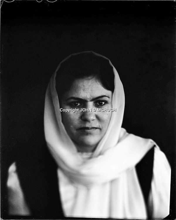 "Fawzai Koofi, Member ofthe Afghan Parliament and women's rights activist, is seen in her home in Kabul, 30 August 2012. This portrait was shot on a 5x4 Linhof Technika IV, circa 1959, and a Schneider Kreuznach 270mm lens, circa 1952, with front tilt, and is part of a series entitled ""Putting an Afghan face on the war."" (John D McHugh)"
