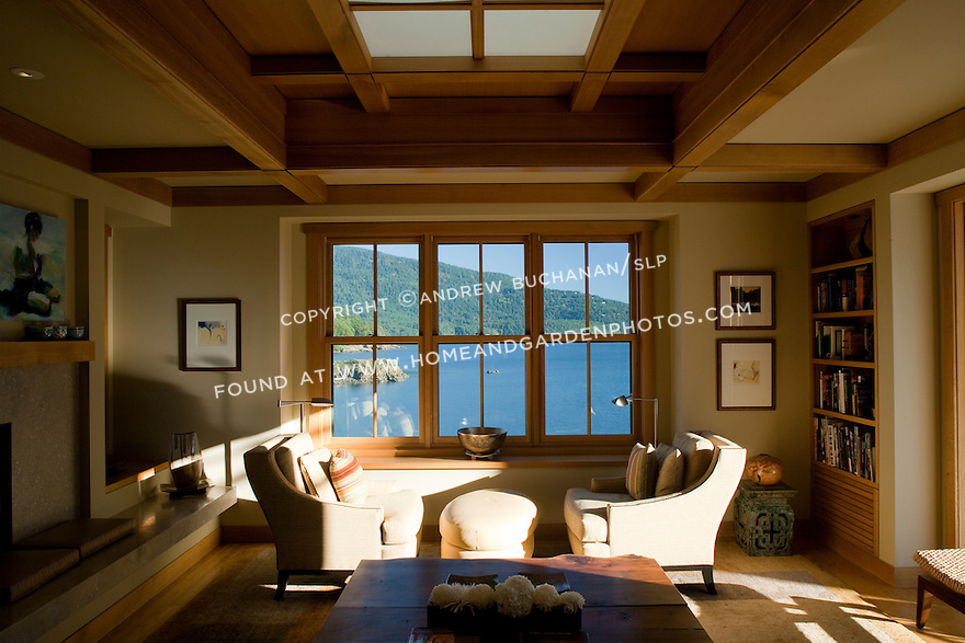 A wall of windows brings beautiful water views into the living room of this waterfront home. this image is available through an alternate architectural stock image agency, Collinstock located here: http://www.collinstock.com