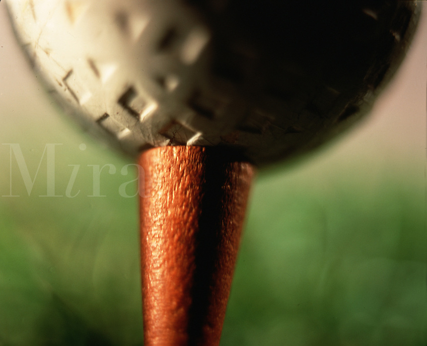 Close up detail of a vintage golf ball and tee.