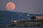 The biggest and brightest Supermoon of the year rose over Alcatraz Island Tuesday night seen from Fort Baker, Sausalito, CA. Supermoons occur when the moon is within 90% of perigee -- which is its closest approach to Earth in orbit. The moon appeared brighter and bigger in the night sky than most months. April's full moon, also known as the pink moon, happens to be the closest of the year