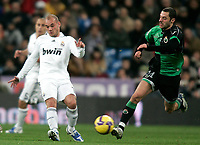 Real Madrid's Wesley Sneijder against Racing de Santander's Mehdi Lacen during La Liga match, January 25, 2009. (ALTERPHOTOS).